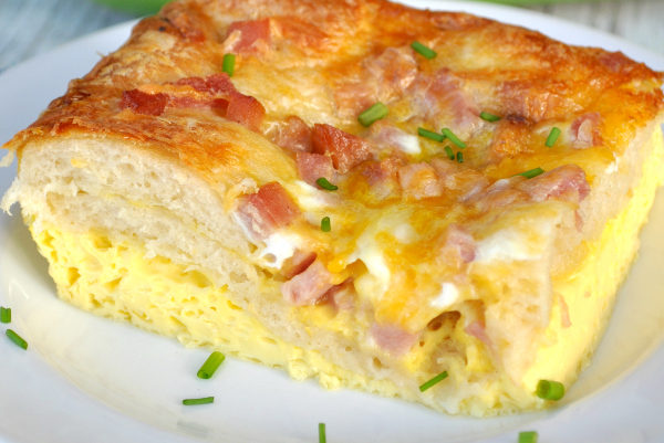 A perfect breakfast {or even lunch... or dinner} use for leftover ham is this amazing Ham Egg and Cheese Crescent Roll Casserole.