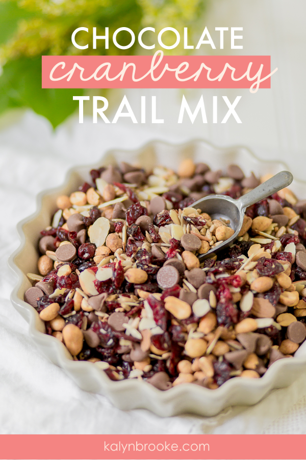 This easy trail mix recipe is not just quick to throw together, it tastes AMAZING! The ratio of chocolate, cranberries, and nuts are perfect—there's never any random nuts left in the bottom with no chocolate to go with it. And, it's a whole lot cheaper than buying trail mix off the grocery store shelf! #homemadetrailmix #trailmixrecipe #chocolatecranberrytrailmix