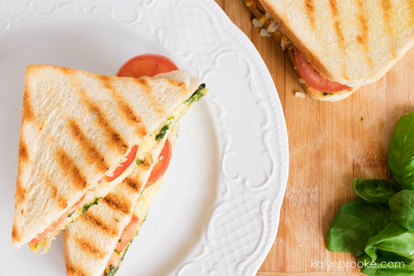 Need a go-to healthy lunch? This cheesy tomato basil sandwich comes together in minutes and is a lighter alternative to a heavy meal. Grilled to perfection, you will love every gooey, flaky, and savory bite!