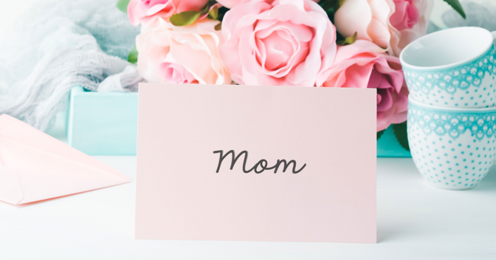 Mom sign among pretty flowers