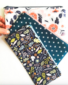 three pretty makeup bags with varying designs