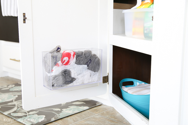 plastic bag holder inside a cabinet
