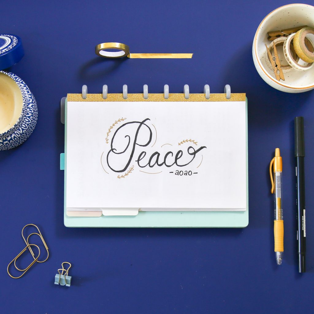 bullet journal flatlay with word of the year: peace