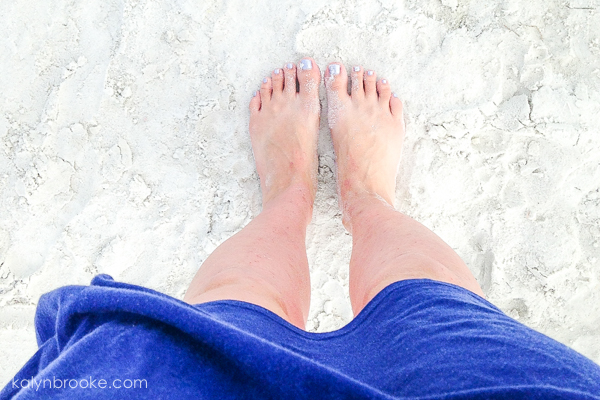 perfect beach day with feet in sand