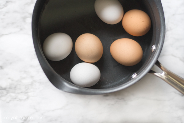 Boiled eggs in pot