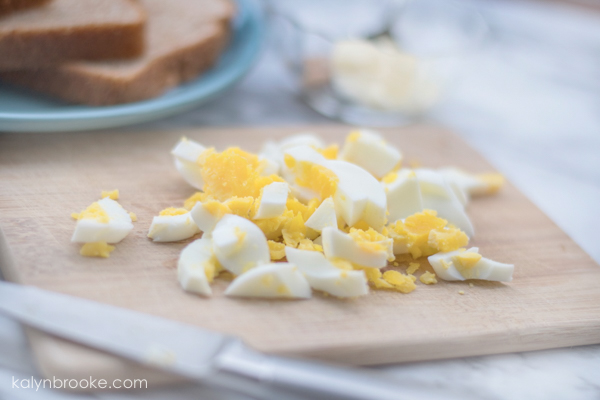 Chopped and boiled eggs on cutting board