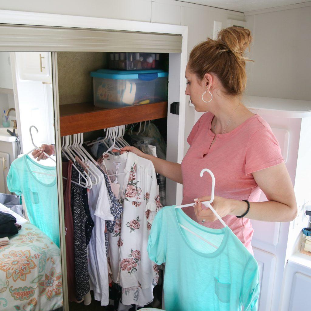 woman decluttering closet